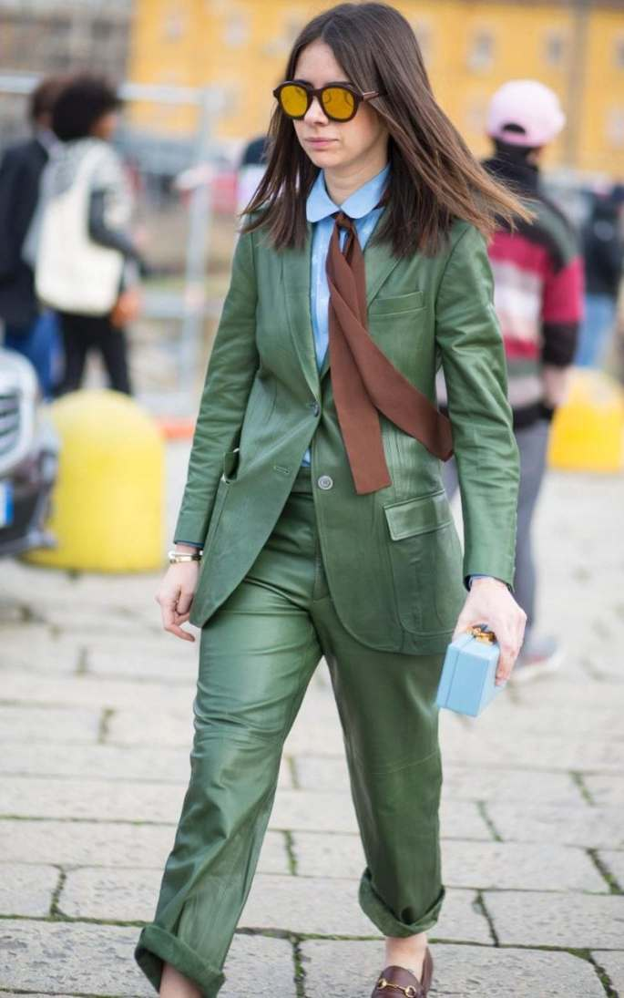 Natasha Goldenberg's already awesome green trouser suit is made all the better with the on-point colour matching with sky blue and brown, and the Annie Hall trailing neck-tie