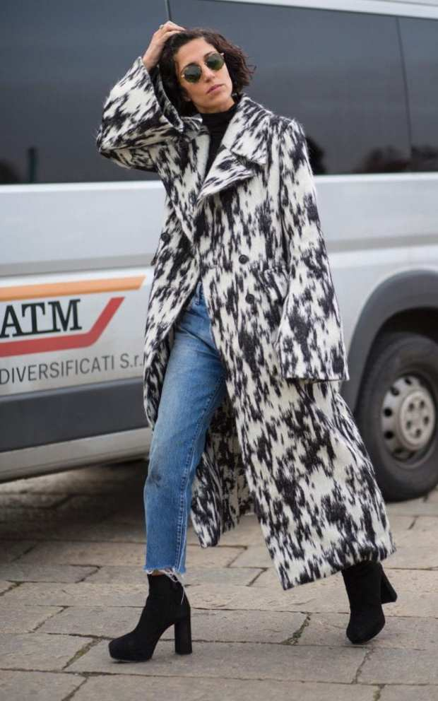 Yasmin Sewell knows the power of a monochrome patterned coat to tie a basic black-and-denim outfit together