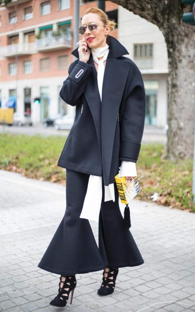 The palette might be monochrome, but this outfit's all drama by virtue of its angular architectural silhouette, stemming from the plunging lapels and fishtail ruffle on the skirt