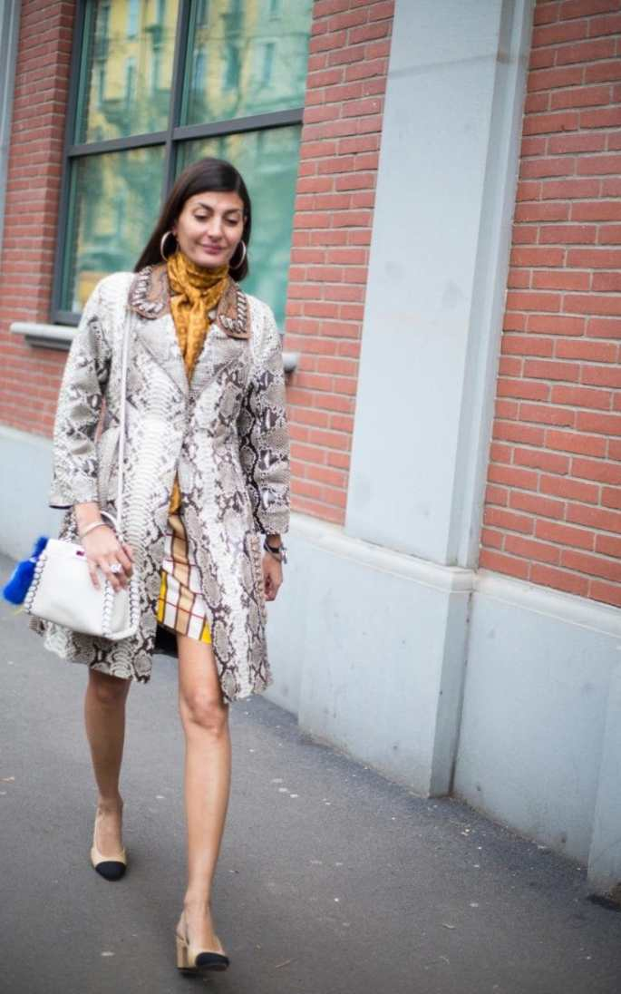 Treat snakeskin as a neutral, like Giovanna Battaglia, and pair it with a mustard yellow printed scarf and co-ordinating geometric skirt. A sassy pair of giant hoops and Chanel two-tone loafers completes the chic European holidaymaker look