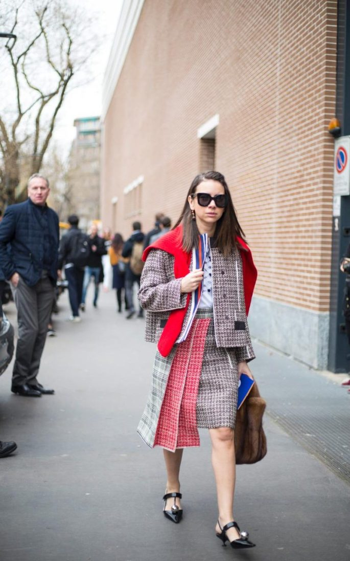 This stylish showgoer's taken her wardrobe ethos from the houses of Prada and Miu Miu, wearing a ladylike classic - the tweed skirt suit - with unexpected sports elements like the go-faster stripes and the tennis skirt pleats