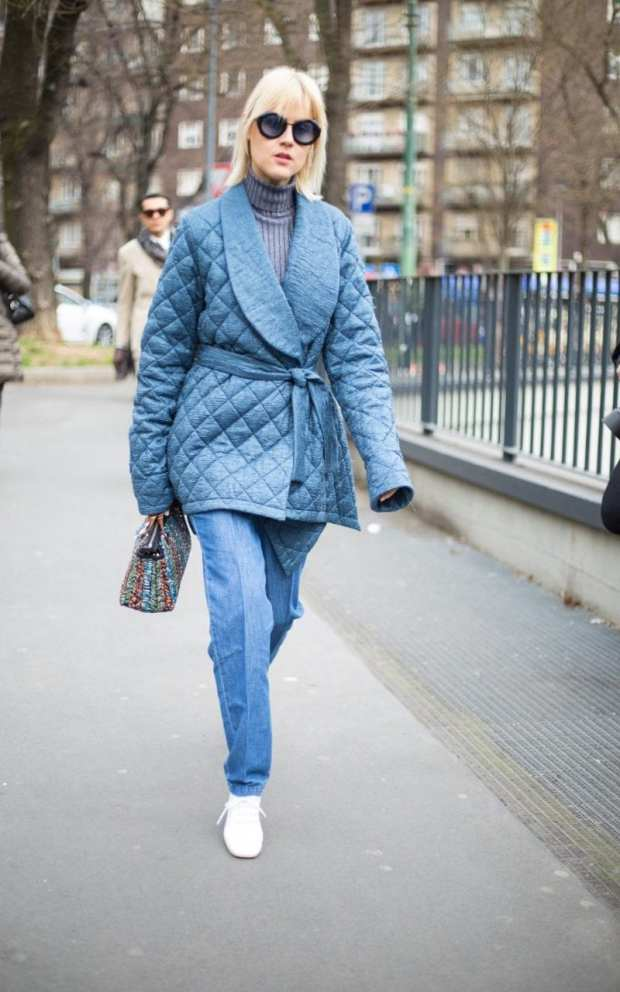 Double denim is no longer a faux pas, as shown by this show attendee's denim dressing gown jacket and crease front jeans