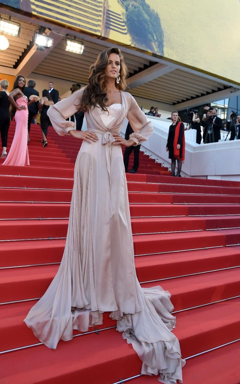 Model Izabel Goulart wears a dusty pink Ralph and Russo flowing robe-inspired gown over a white bodice (as worn on the runway) to the premiere of Julieta
