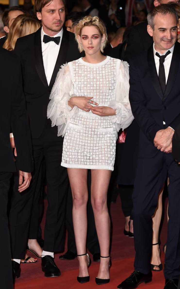Kristen Stewart wears a white Chanel mini dress with dramatic sleeves from the Resort 2017 collection to the premiere of Personal Shopper