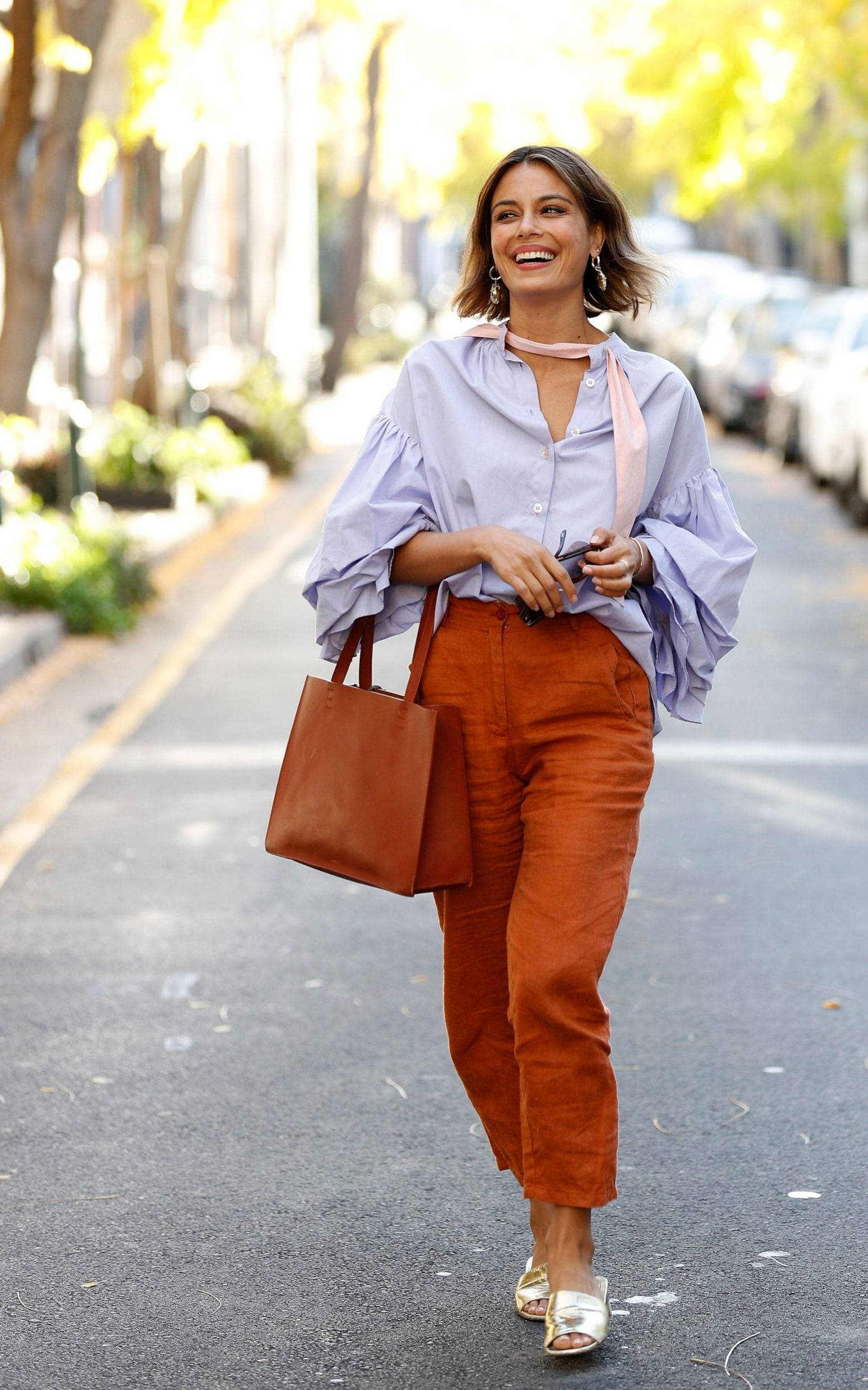 Why terracotta is the colour of the summer   and how to wear it Nathalie Kelley paired terracotta trousers with a blue blouse to excellent  effect while out and about in Sydney  Australia Credit  Getty