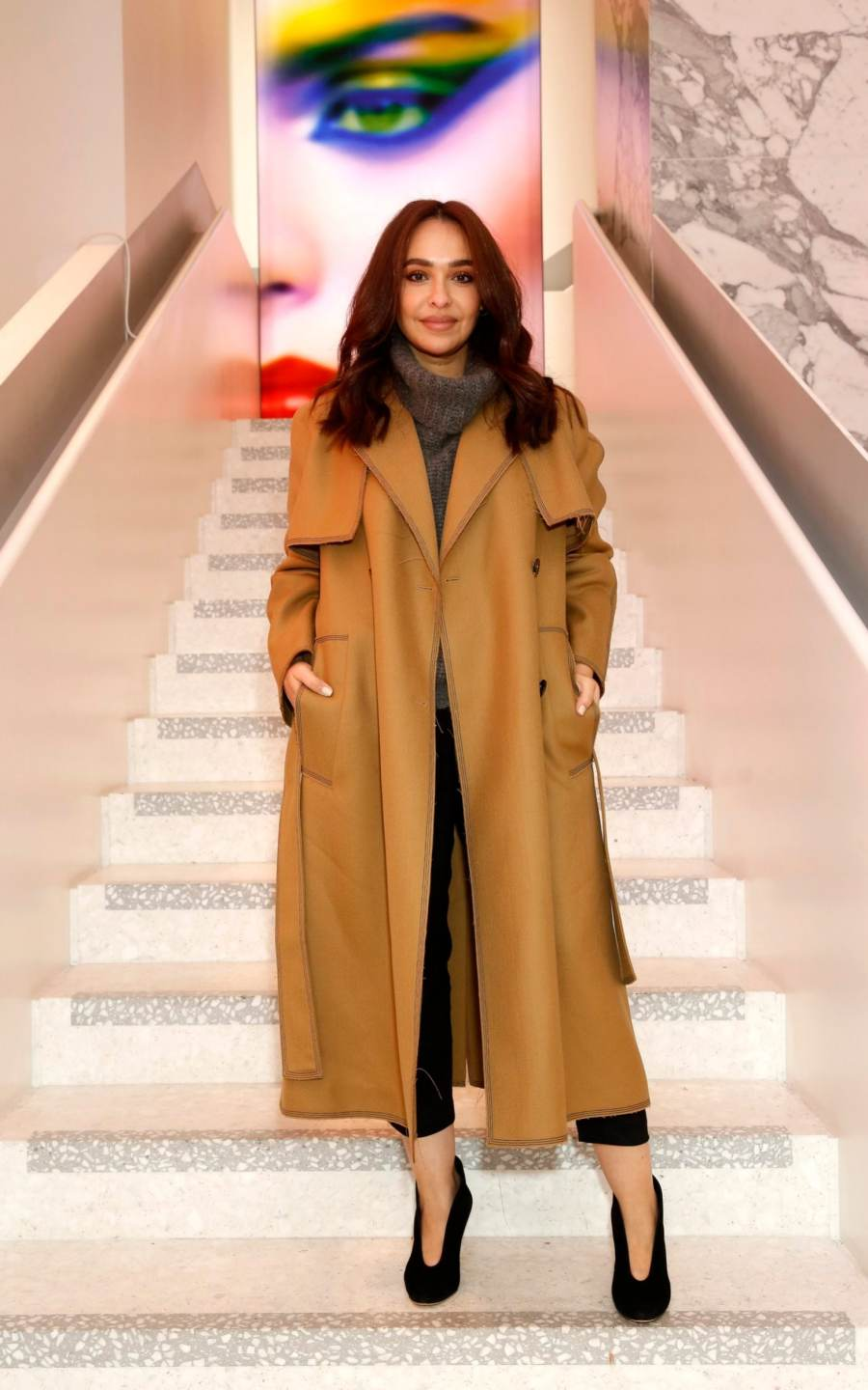 Ghizlan Guenez in a brown trench coat
