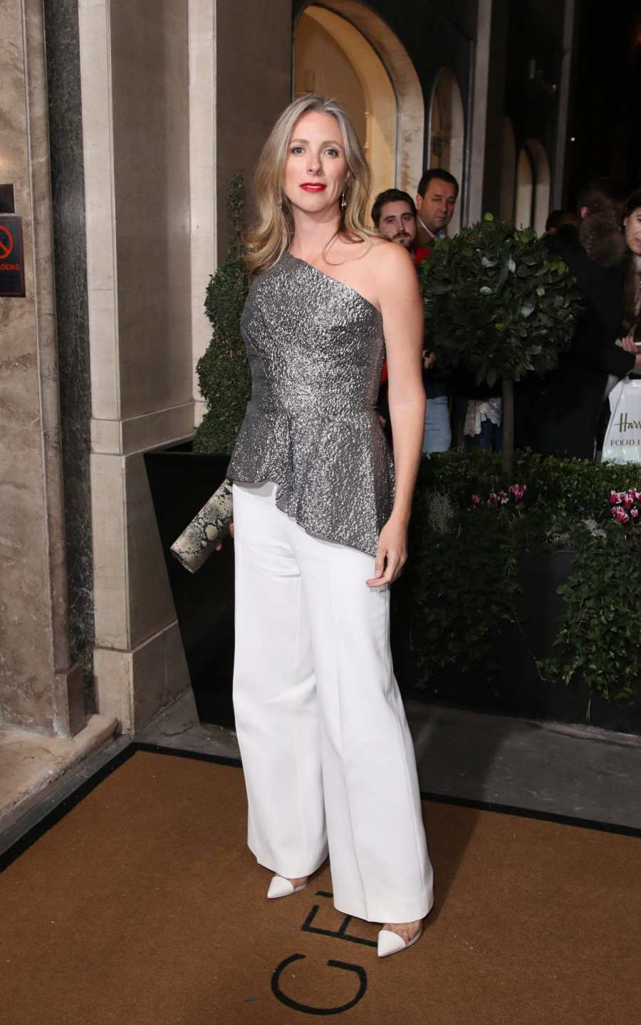 stephanie phair in an off the shoulder top and white trousers