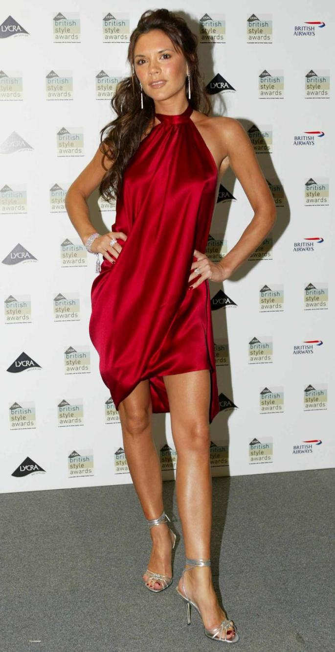 Looking relaxed in a fiery-hued number at the British Style Awards in 2003