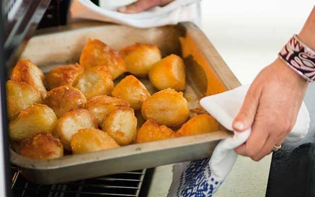 Roast potatoes coming out of the oven