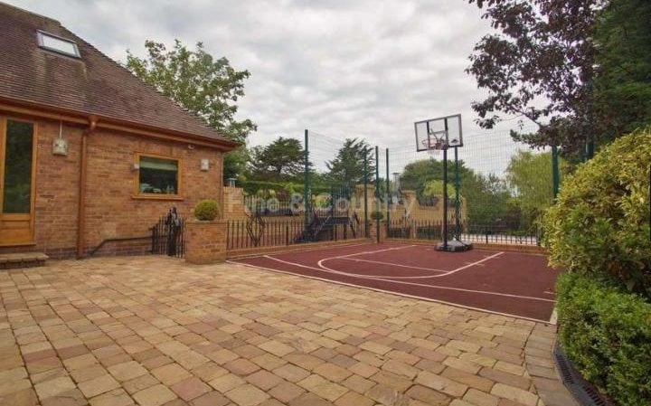 Raheem Sterling half basketball court