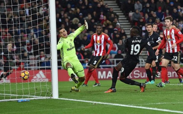 Sadio Mane steals in at the far post to put Liverpool 2-1 up