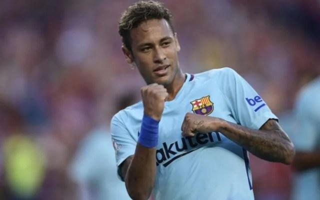 Neymar of Barcelona gestures after scoring against Manchester United