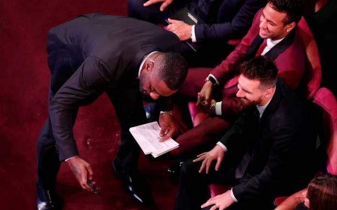 Actor Idris Elba takes a selfie with Barcelona's Lionel Messi and Paris Saint-Germain's Neymar