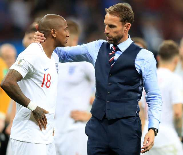England Manager Gareth Southgate Embraces Ashley Young After The Fifa World Cup Semi Final Match
