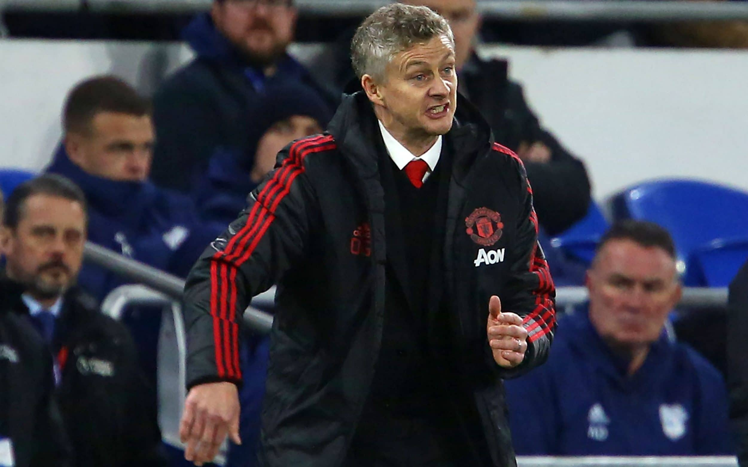 Ole Gunnar Solskjaer gestures to the players