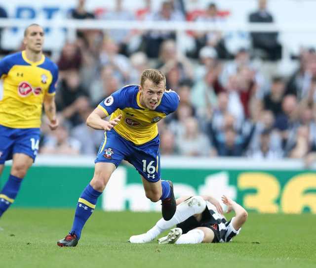 James Ward Prowse Of Southampton Brings Down Miguel Almiron Of Newcastle United During The Premier