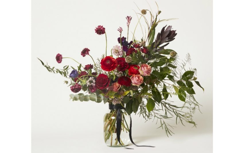 Grace and Thorn flower delivery's Hackney Red bouquet with red roses and foliage