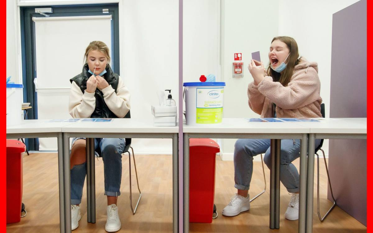 Students Ellie Fisher (left) and Beth Hicks (right) take Coronavirus lateral flow tests at Outwood Academy Adwick