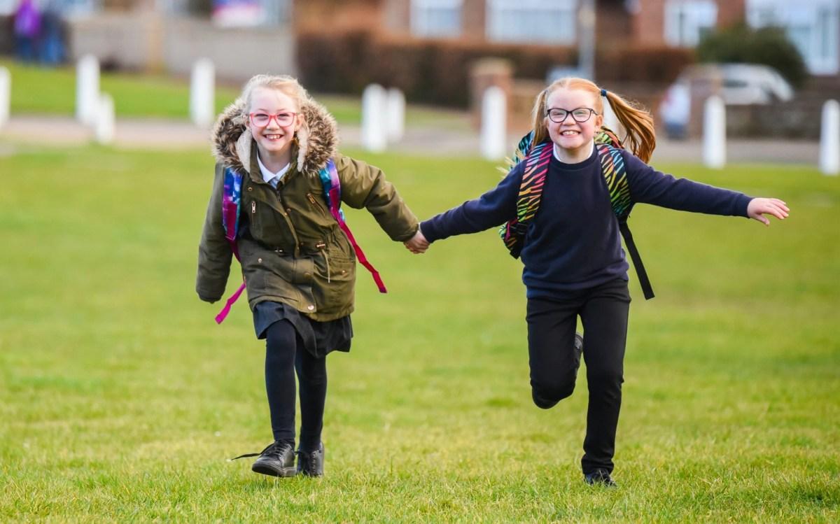 Twins, Summer & Sophia Ellis (8) heading off to school in Kings Lynn, Norfolk, on Monday morning