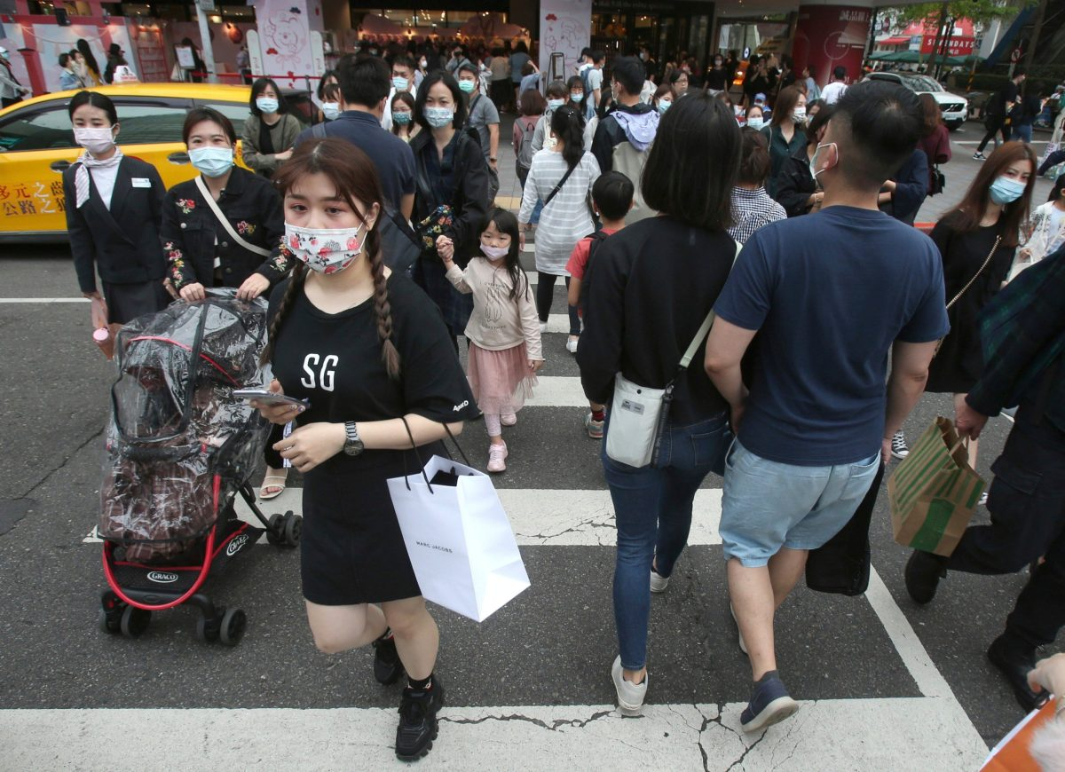Pedestrians wear face masks in Taipei, Taiwan, where life has largely returned to normal