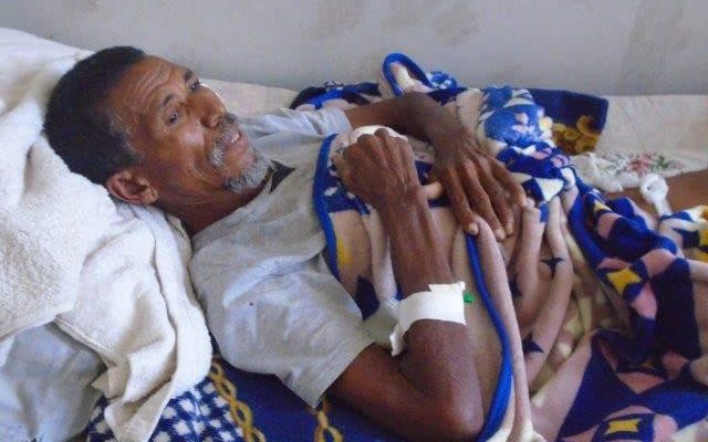 60-year-old Amdemaryam Mebrahtu, a survivor of the massacre recovers in hospital