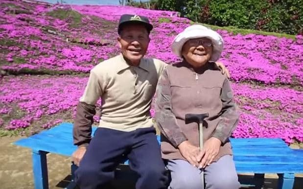 Mr and Mrs Kuroki at their flower garden in Shintomi, Miyazaki Prefecture