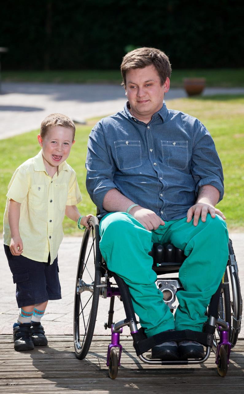 Brecon Vaughan with Dan Black, who helped raise funds for surgery that enabled Brecon to walk