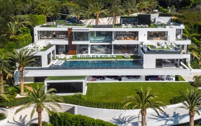 The Billionaire house in Bel Air is on sale for $250m through Christie's International Real Estate , including $30m worth of cars in the car gallery, 100 curated art installations and a wall of sweets.