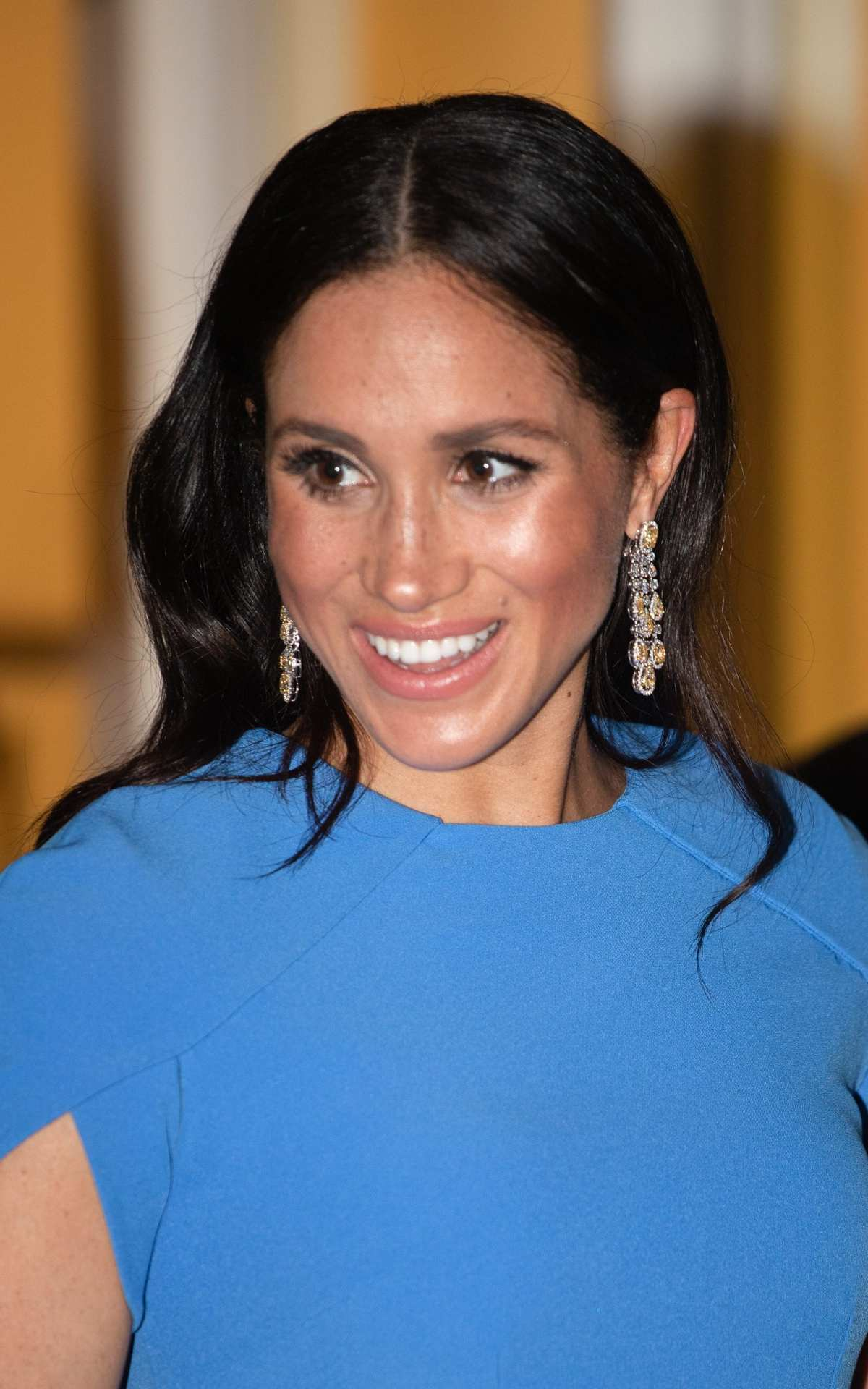 Meghan wearing the diamond chandelier earrings that have caused controversy, at a state dinner in Fiji in 2018