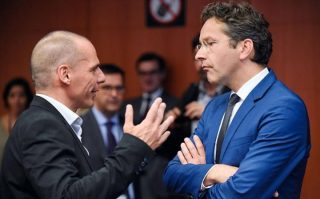 Yanis Varoufakis talks with Dutch Finance Minister and president of Eurogroup Jeroen Dijsselbloem