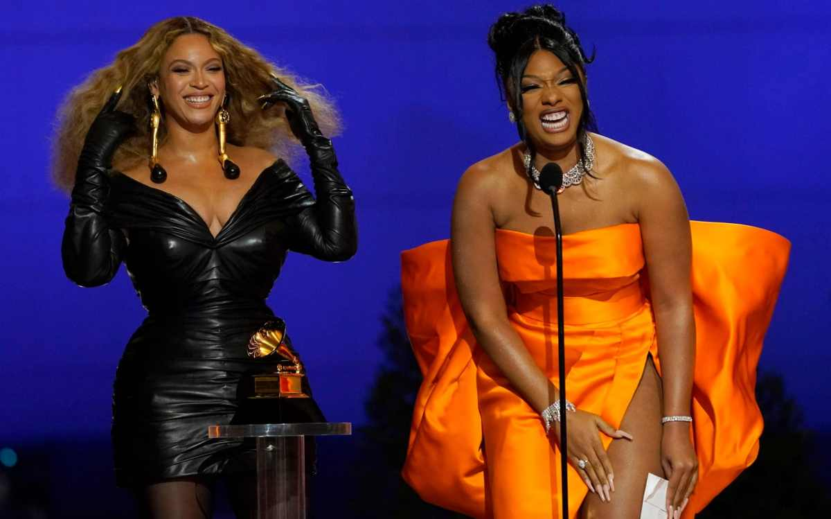 """Beyonce, left, and Megan Thee Stallion accept the award for best rap song for """"Savage"""""""