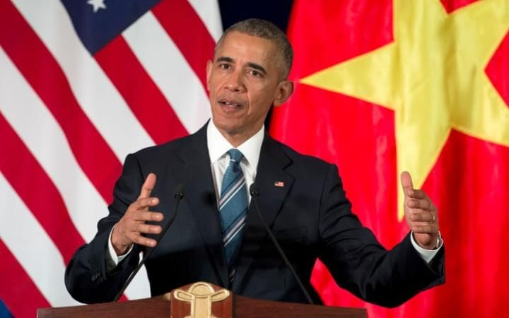 U.S. President Barack Obama speaks during a news conference with Vietnamese President Tran Dai Quang at the International Convention Center in Hanoi
