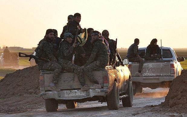 Kurdish YPG fighters on the outskirts of Tal Hamees in a file picture