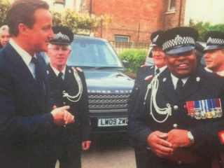 Cornell Barnes, right, meeting David Cameron on a trip to Coventry