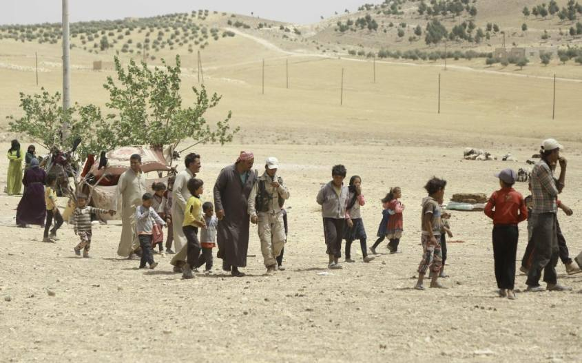 Syrian families, who fled the assault launched by Arab and Kurdish forces against Islamic State (IS) group fighters in the town of Manbij, arrive at an encampment on the outskirts of the town