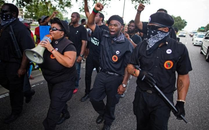 https://i1.wp.com/www.telegraph.co.uk/content/dam/news/2016/07/10/102894867_Members_of_the_New_Black_Panther_Party_march_in_front_of_the_Baton_Rouge_Police_Department-large_trans++ZgEkZX3M936N5BQK4Va8RWtT0gK_6EfZT336f62EI5U.jpg