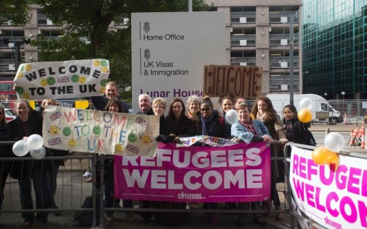 "Citizens UK welcome Refugees from ""The Jungle"" Calais camp as they arrive at Lunar House."