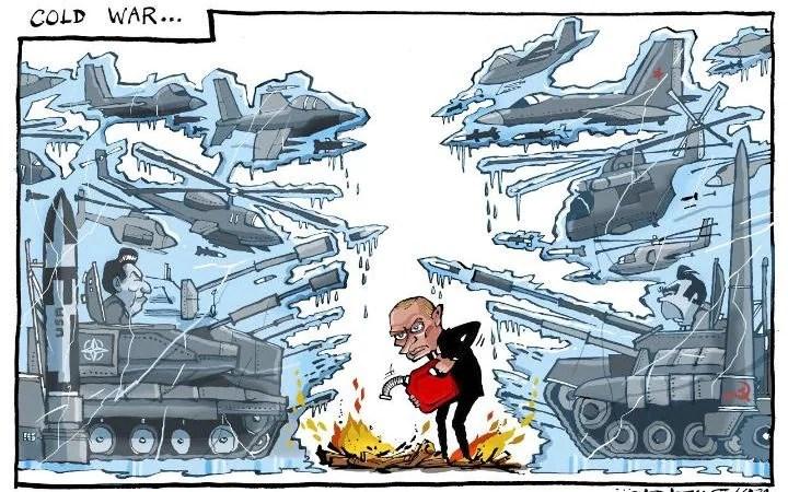 Adams cartoon: Putin stoking the fires of war