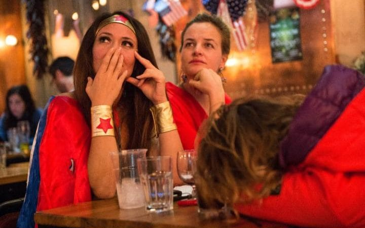 American Democratic Party supporters, one in a Wonder Woman costume, react to the news that Donald Trump has won the state of Florida at the Democrats Abroad election night party at Marylebone Sports Bar and Grill, in London