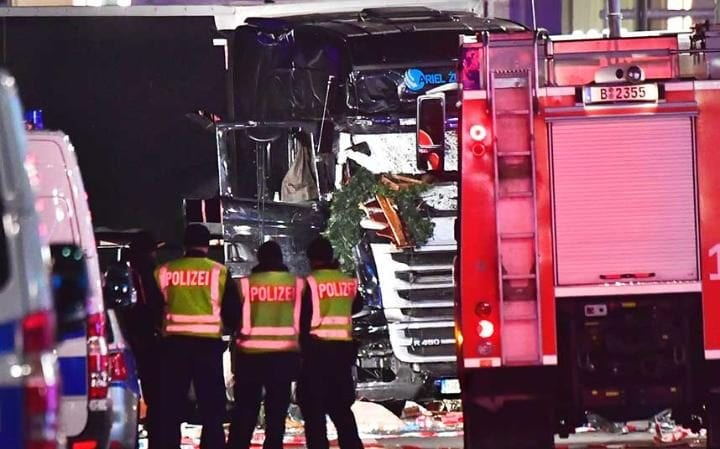Police officers inspect the lorry that crashed into a Christmas market at Gedächniskirche church in Berlin