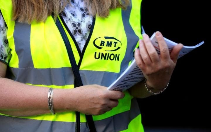 An RMT worker hands out leaflets
