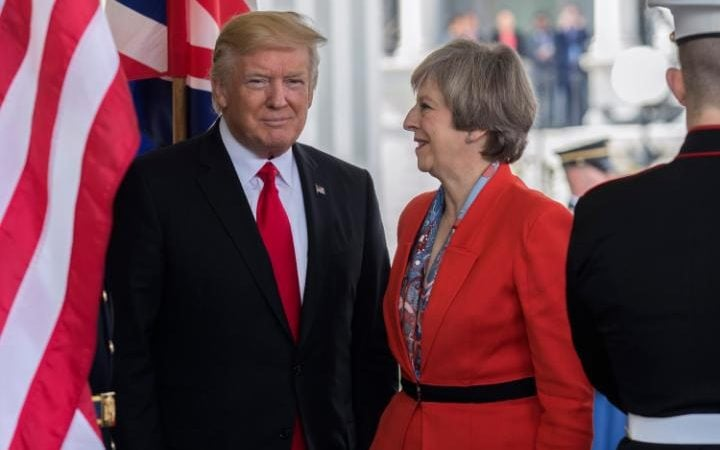 US President Donald J. Trump greets British Prime Minister Theresa May as she arrives at the White House in Washington, DC, USA, 27 January 2017