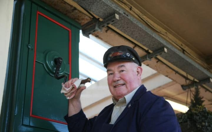 Jim Walker winding the clock up at Carnforth station, before the row over his remarks on child migrants