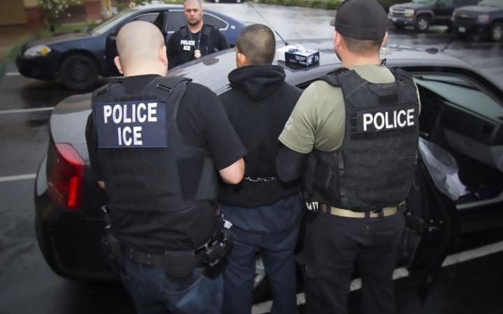 This image obtained February 11, 2017 courtesy of the Immigration and Customs Enforcement (ICE) shows US Immigration and Customs Enforcement officers detaining a suspect during an enforcement operation on February 7, 2017 in Los Angeles, California.