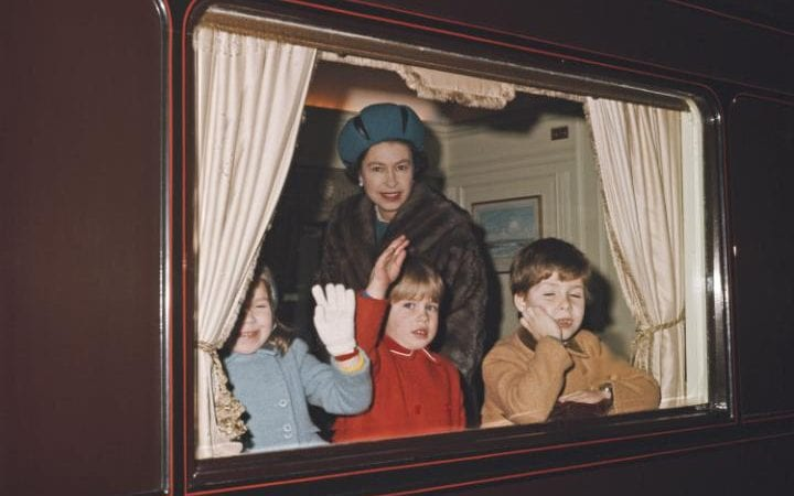 The Queen with Prince Andrew (right) and Prince Edward (centre) in a compartment of the Royal Train before departure from London in December 1965