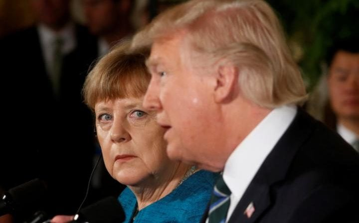 Germany's Chancellor Angela Merkel and U.S. President Donald Trump hold a joint news conference in the East Room of the White House in Washington, U.S., March 17, 2017