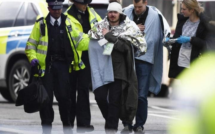 A member of the public is treated by emergency services near Westminster Bridge