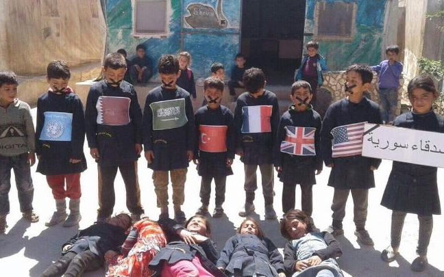 Children in Idlib, Syria, protest against international inaction after the chemical attack on Khan Sheikhoun