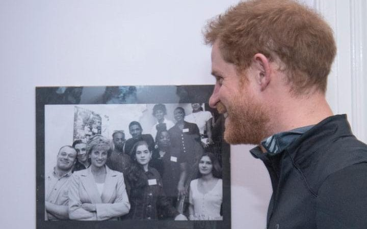 Prince Harry with a picture of his mother Princess Diana, with staff and users of The Running Charity, which is the UK's first running-orientated programme for homeless and vulnerable young people, in Willesden in north west London.