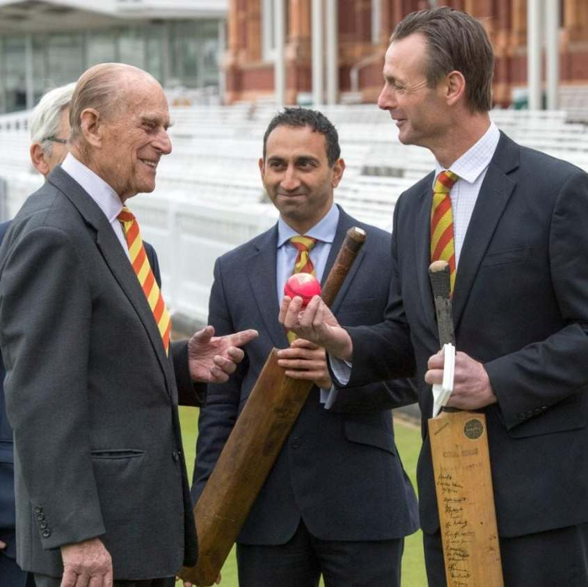 The Duke of Edinburgh (second left) is shown a number of bats by Dr Chinmay Gupte (second right) and John Stephenson (right), during a visit to Lord's cricket ground